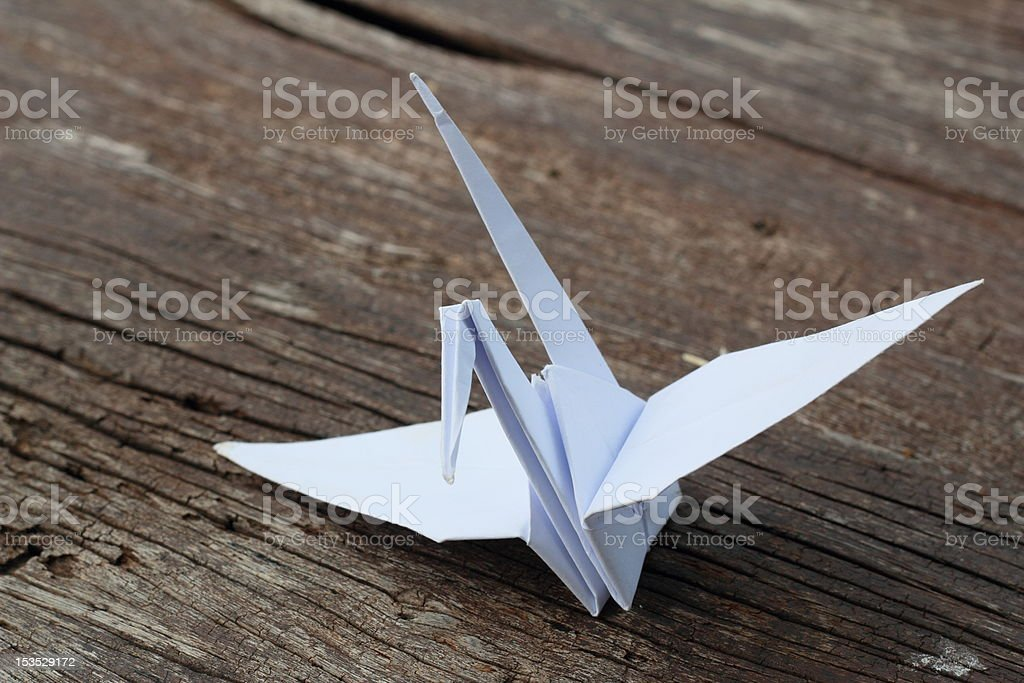 Origami bird placed on the floor brown. royalty-free stock photo