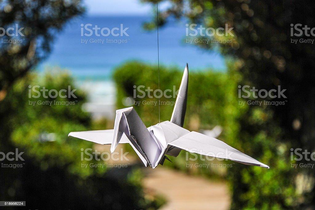 Origami Crane on the beach stock photo