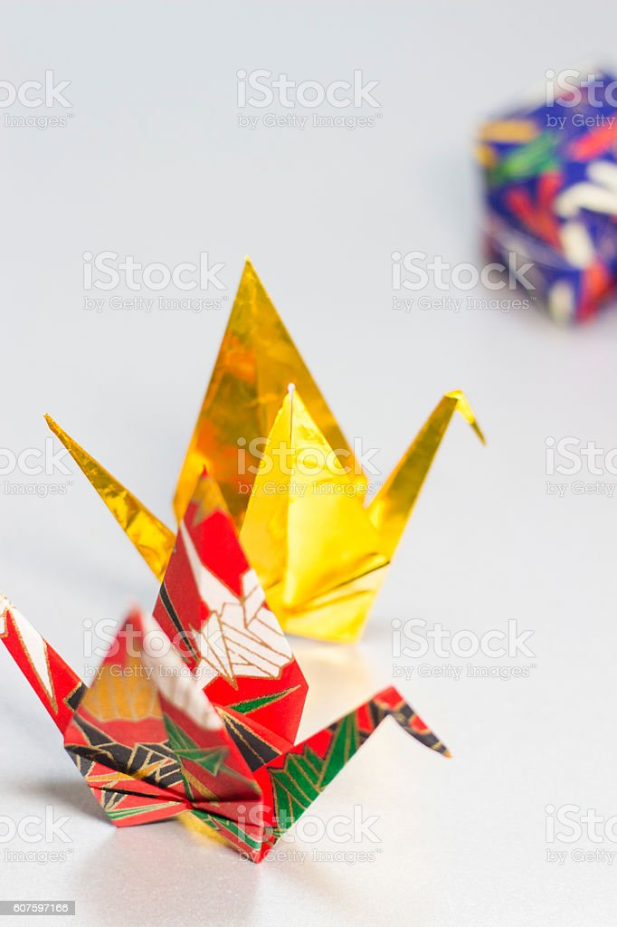 Origami cranes and paper balloon stock photo