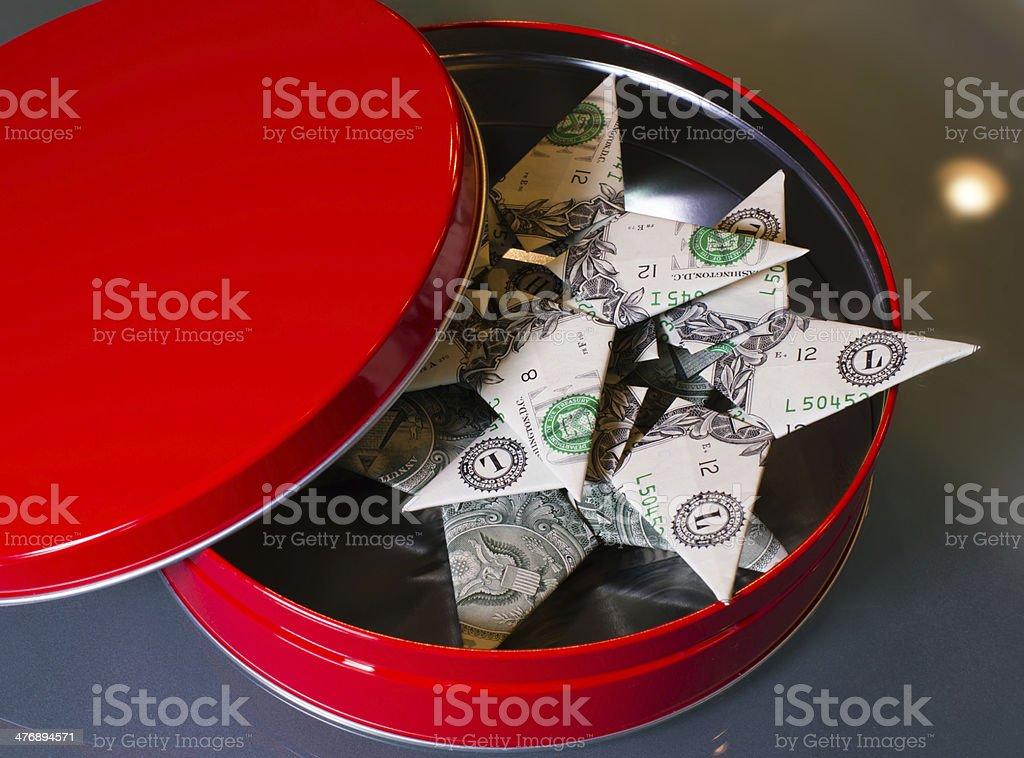 Origami dollar bill stelle in rosso scatola regalo foto stock royalty-free