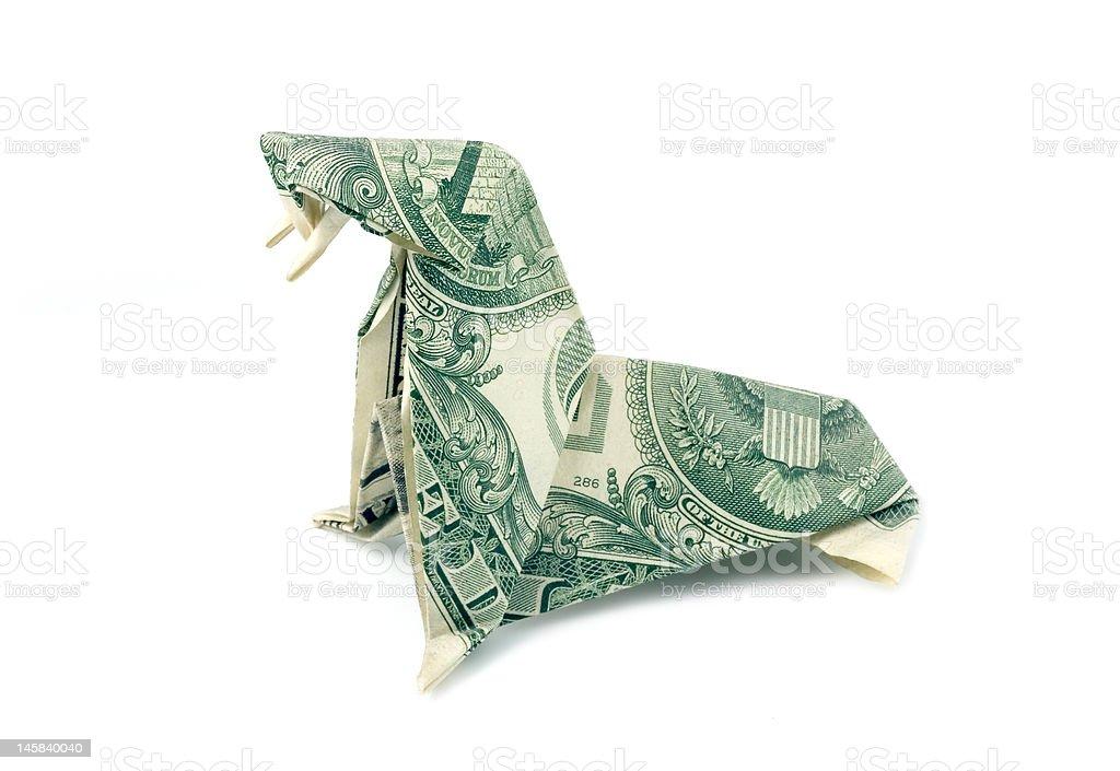 Origami-Dollar plié dans la forme d'un morse. photo libre de droits