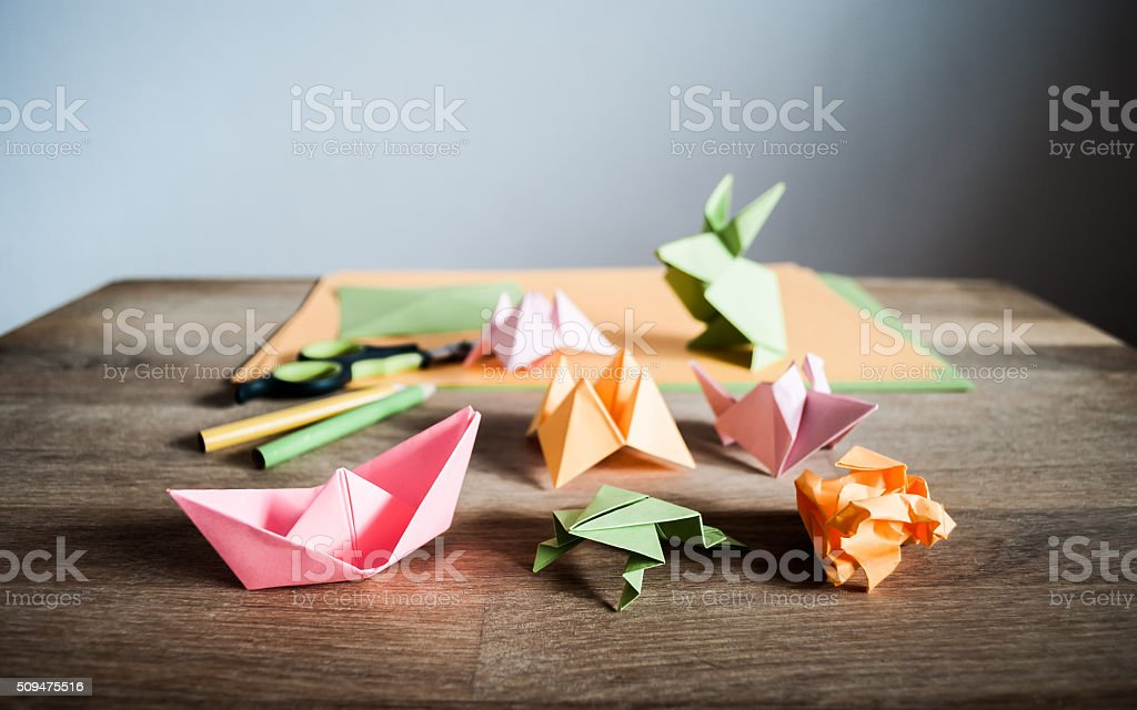Origami figurines on a table. stock photo