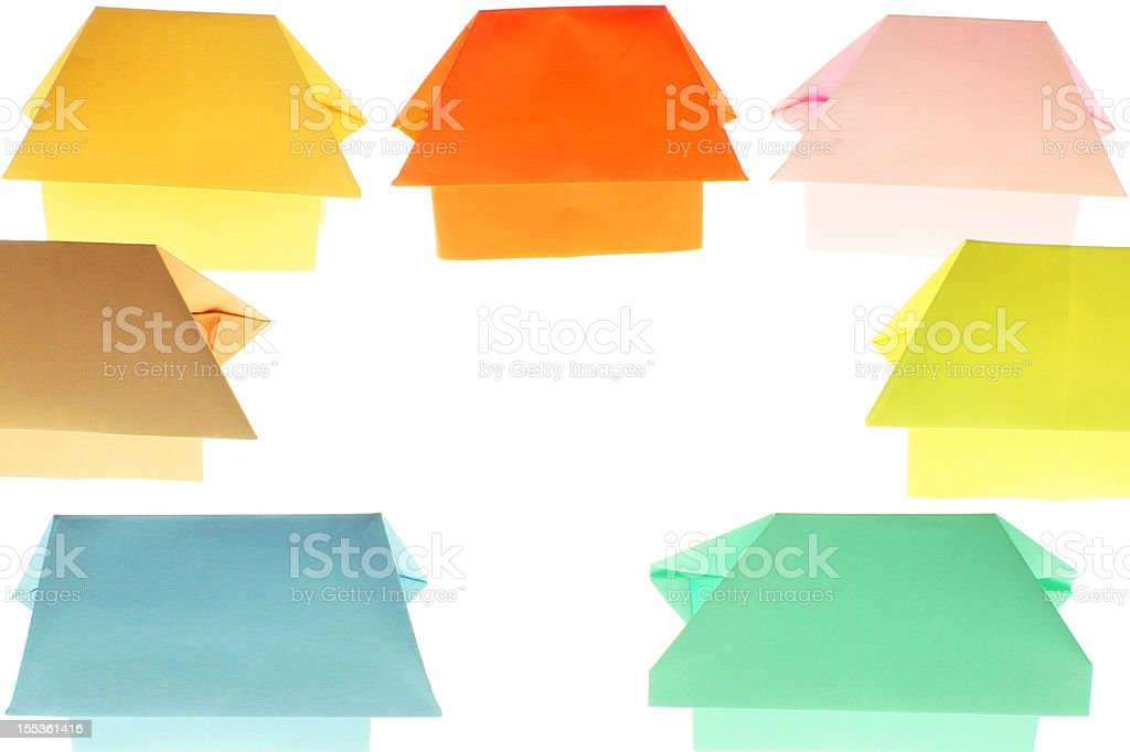 Origami homes with central copyspace stock photo
