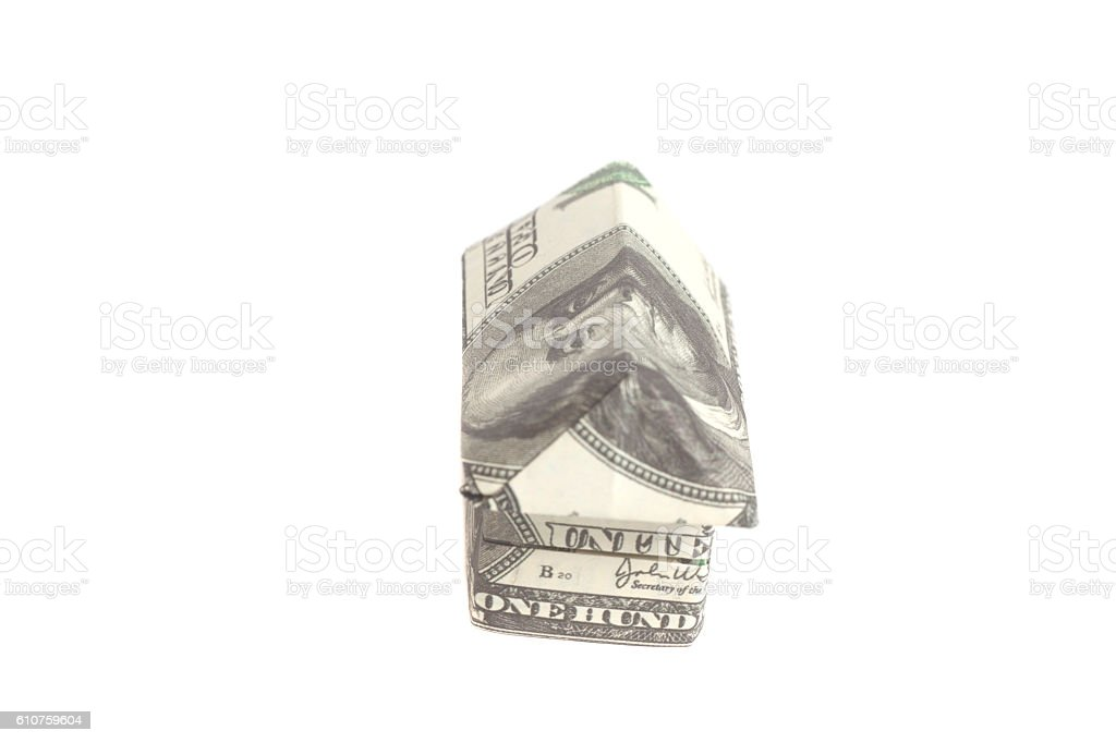 Origami house made of 100 dollar banknotes stock photo