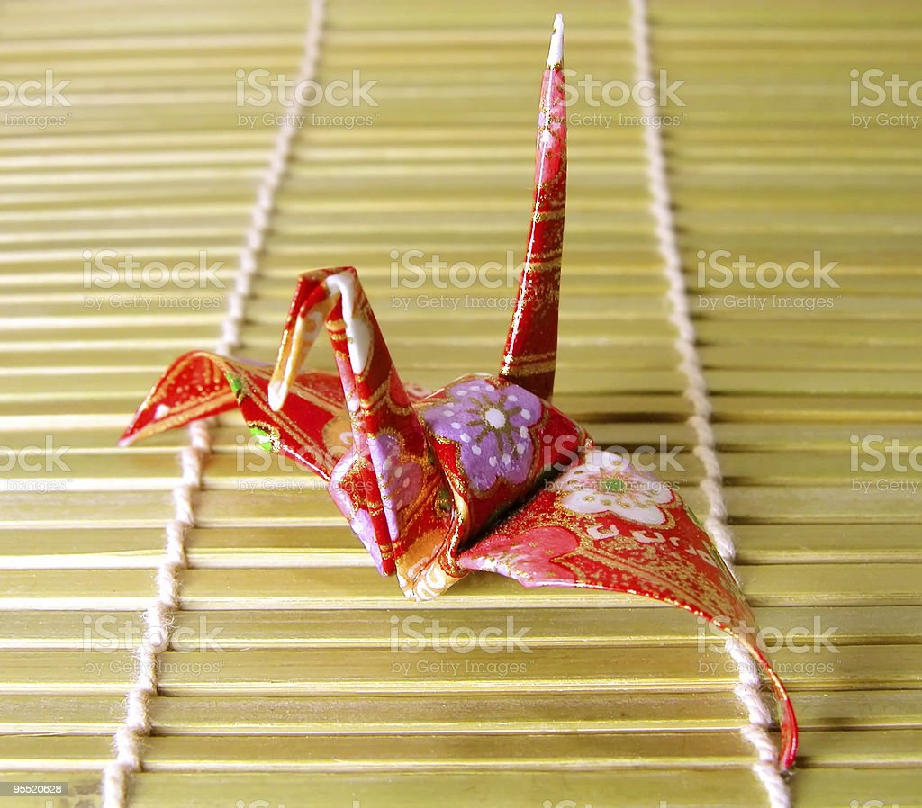 Origami on a bamboo floor royalty-free stock photo