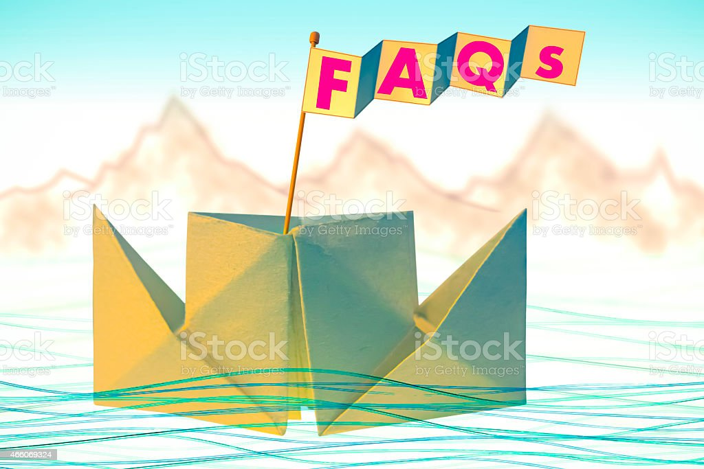 Origami paper boat with flag writing FAQs stock photo