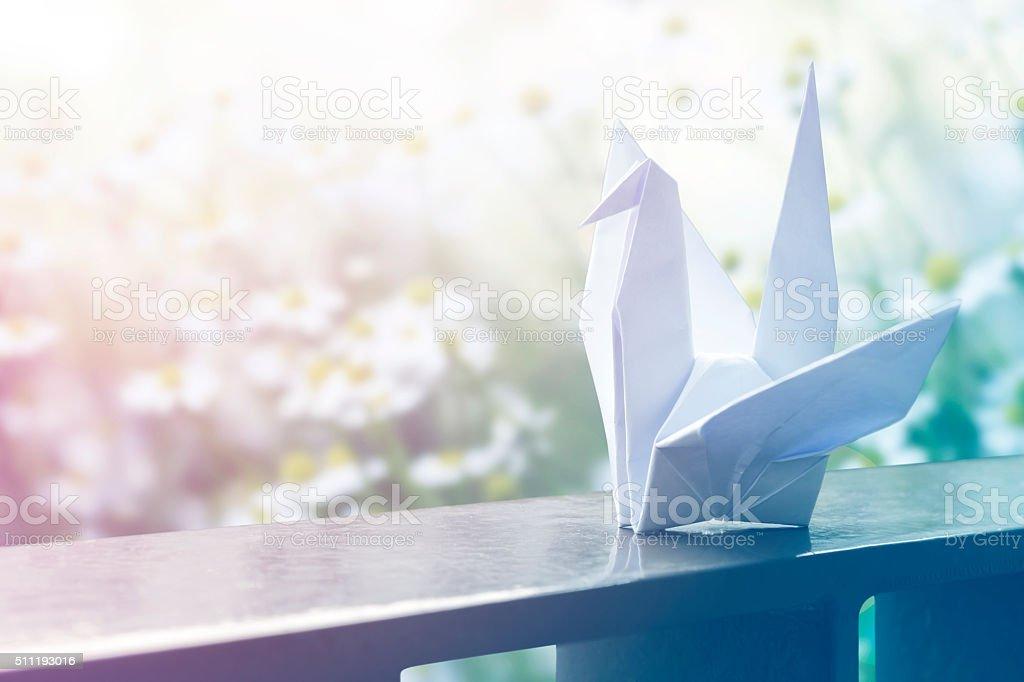Origami paper crane on the balcony stock photo