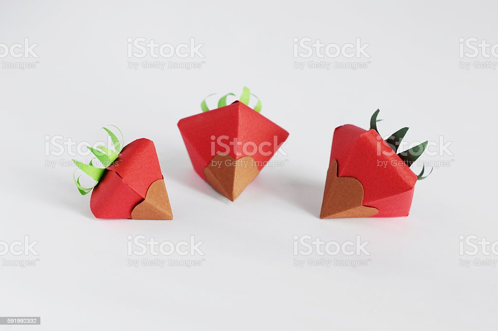 Origami Strawberries with Chocolate stock photo