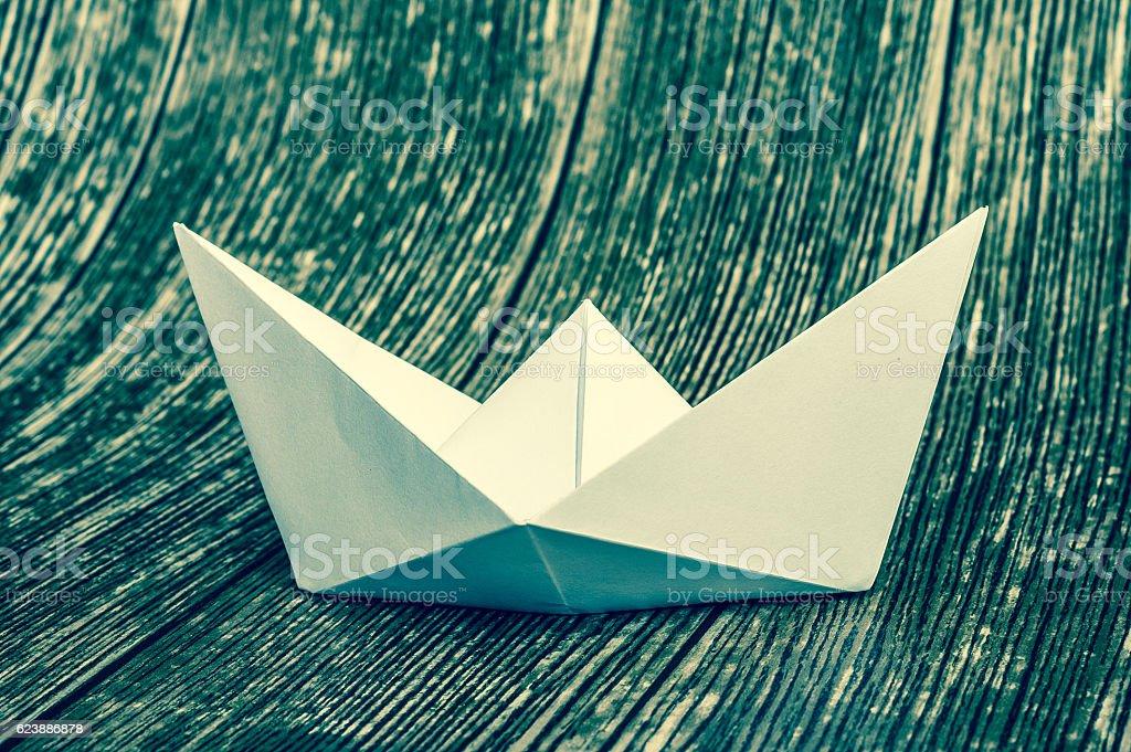 Origami white paper boat stock photo