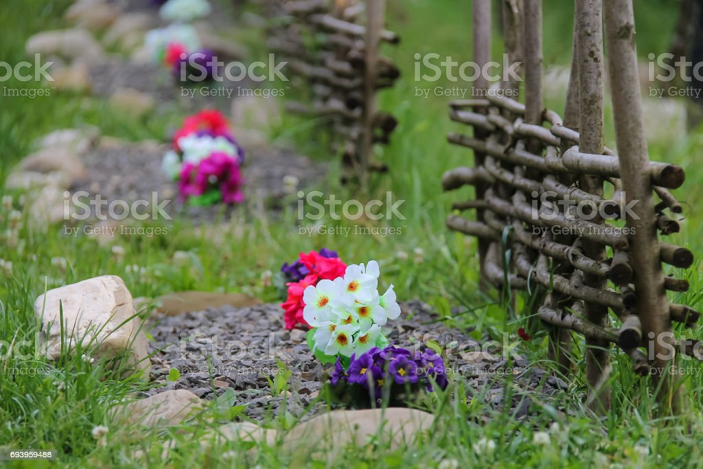 Original flowerbed with decorative fence stock photo