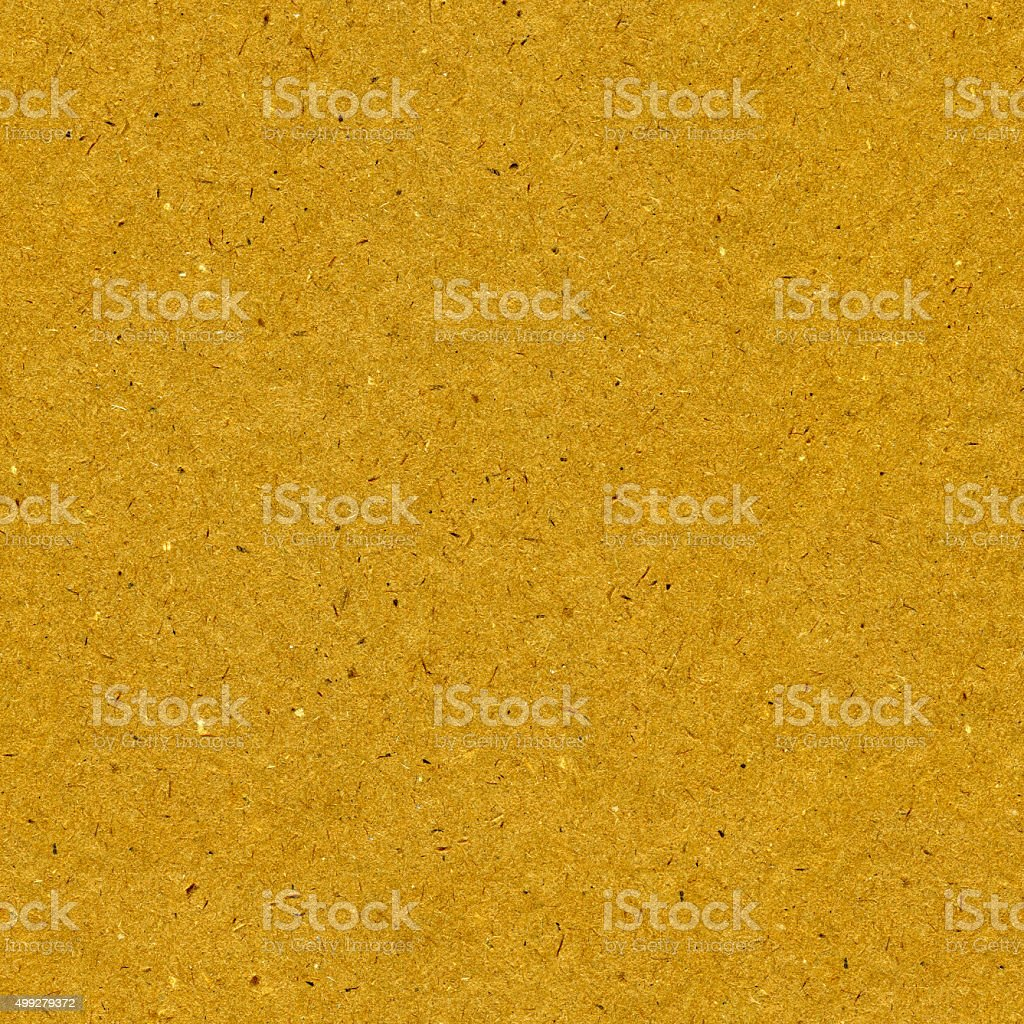 Original seamless dappled polluted golden brown building fiberboard texture background stock photo