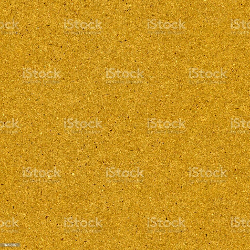 Original seamless dappled polluted golden brown building fiberboard texture background stock photo