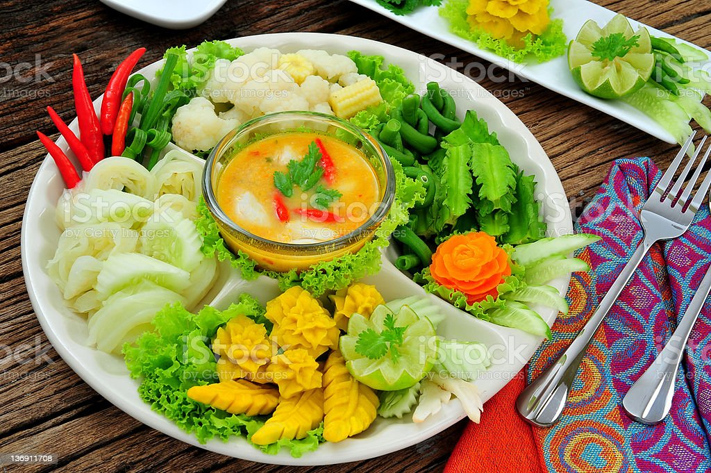 original Thai food with carved vegetables on well decorated plate royalty-free stock photo
