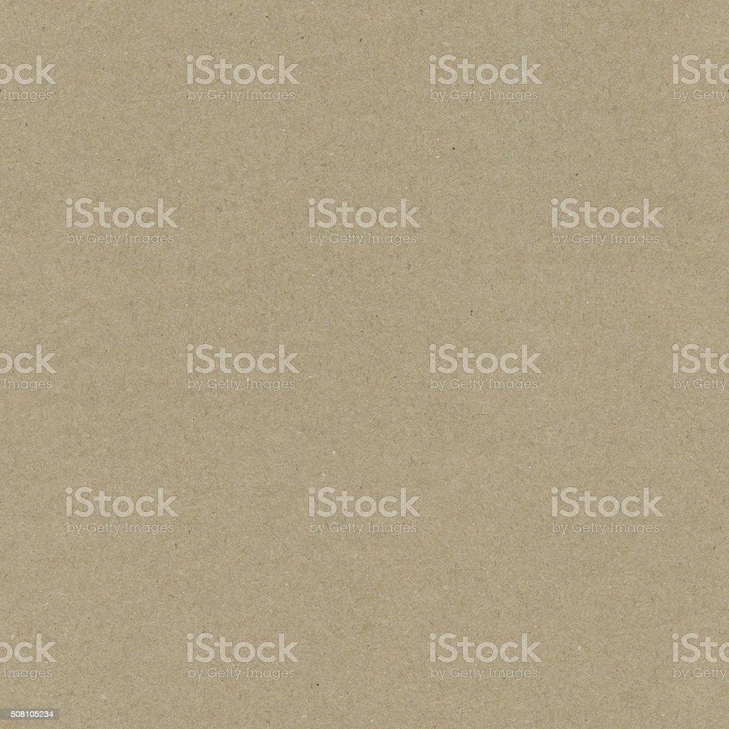 Original unfinished sheet of natural manufactured recycled brown wrapping paper stock photo