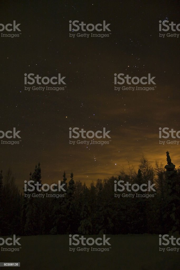 Orion constellation near the horizon above town lights royalty-free stock photo