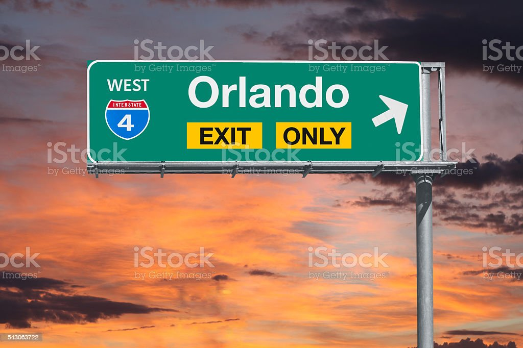 Orlando Florida Exit Only Freeway Sign with Sunrise Sky stock photo