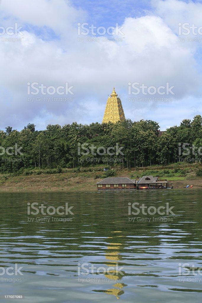 Ornament: natural scene of wooden raft house and gold pagoda royalty-free stock photo