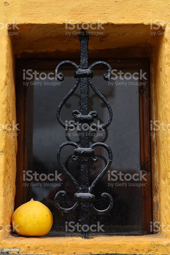 Ornamental forged metal lattice on a basement window stock photo