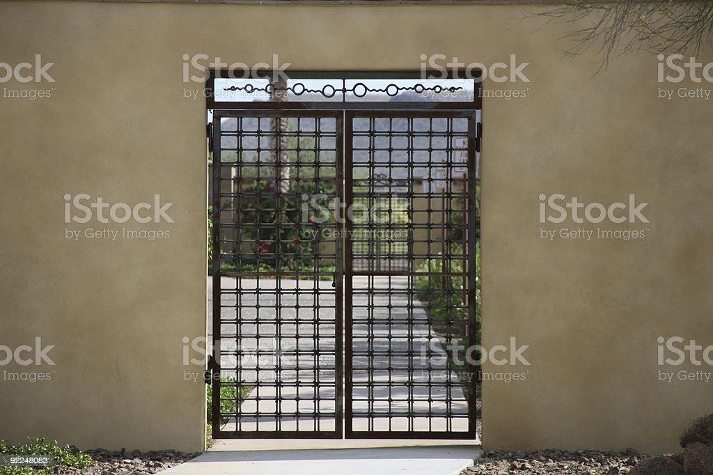 Ornamental iron courtyard gates royalty-free stock photo