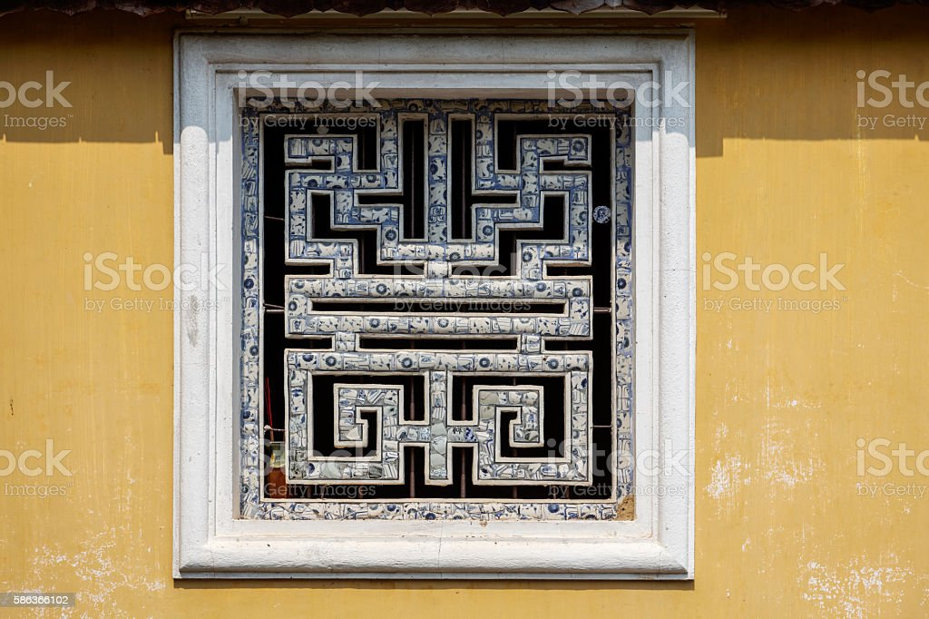 Ornamental window in Hue, Vietnam stock photo