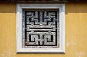 Ornamental window in Hue, Vietnam