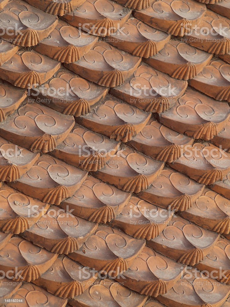 Ornamented roof tiles stock photo