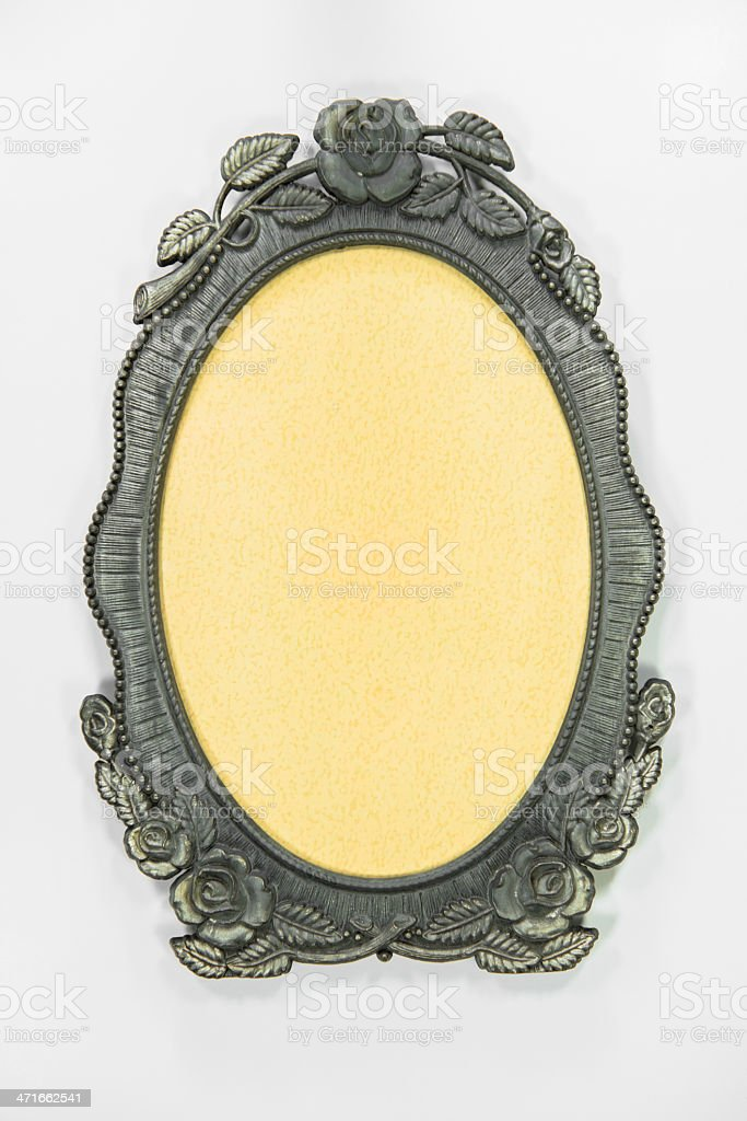 Ornamented, silver plated empty picture frame for putting your pictures royalty-free stock photo