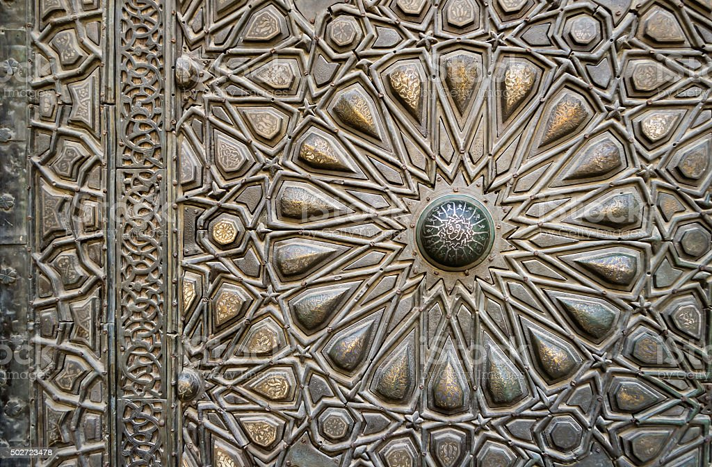 Ornaments of the bronze-plate door of an old mosque stock photo