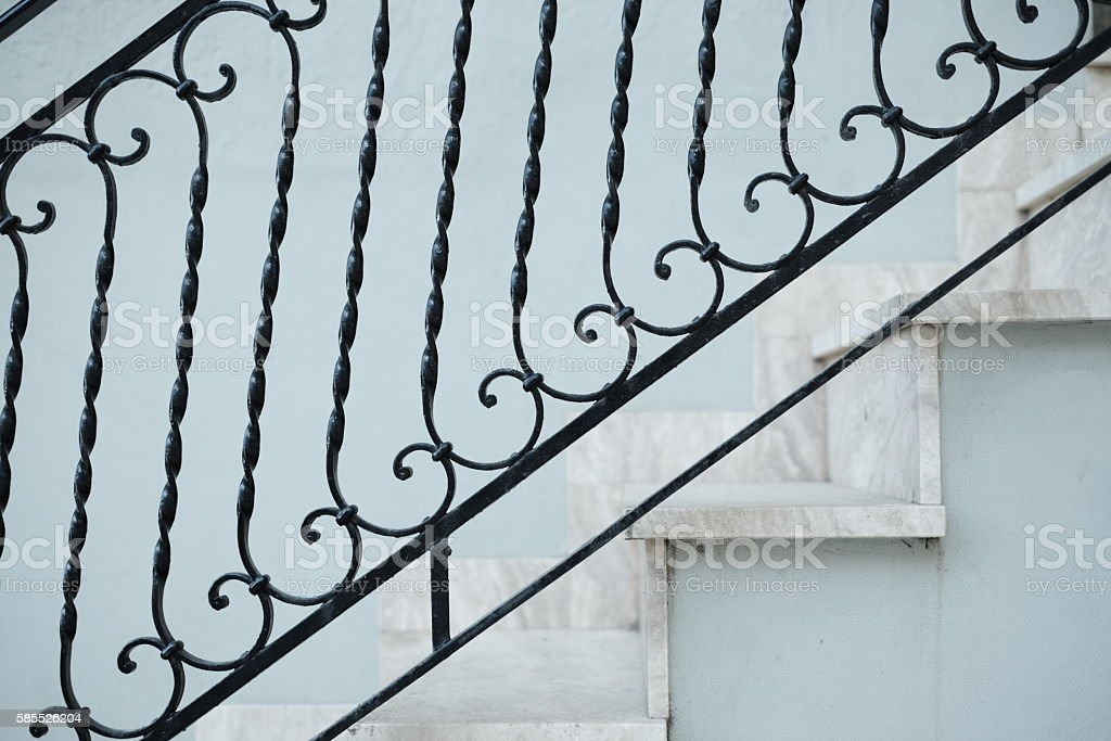 Ornate black handrail, staircase, steps stock photo