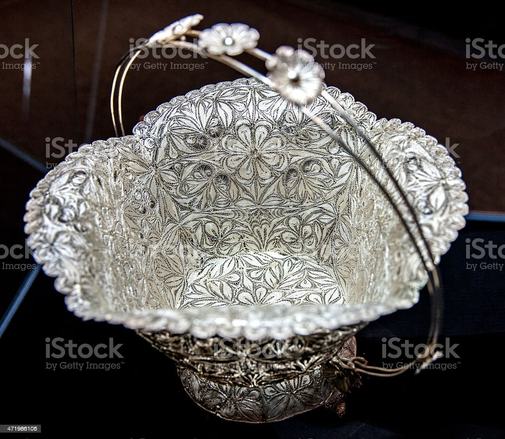 Ornate bowl made out of silver stock photo