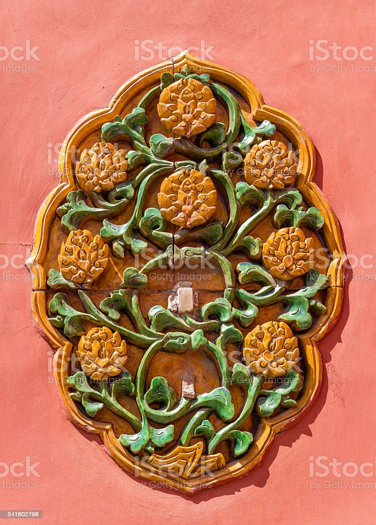 Ornate ceramic decoration on a wall of the Forbidden City stock photo