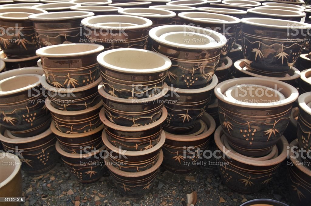 Ornate ceramic plant pots - Brown stock photo