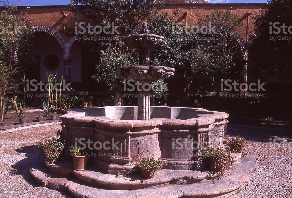 Ornate courtyard fountain and gardens San Miguel de Allende Mexico stock photo