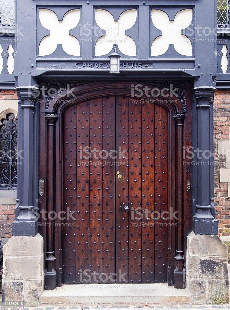 Ornate dark wood entrance door royalty-free stock photo