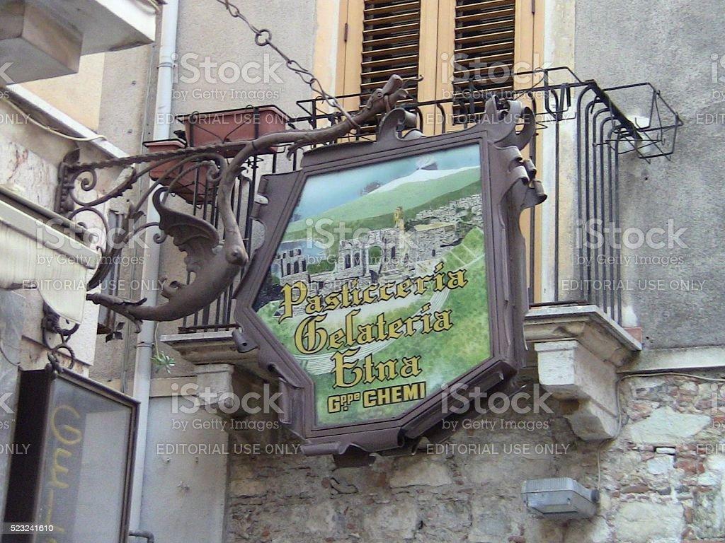 Ornate Dragon Shop Sign in Taormina, Italy stock photo