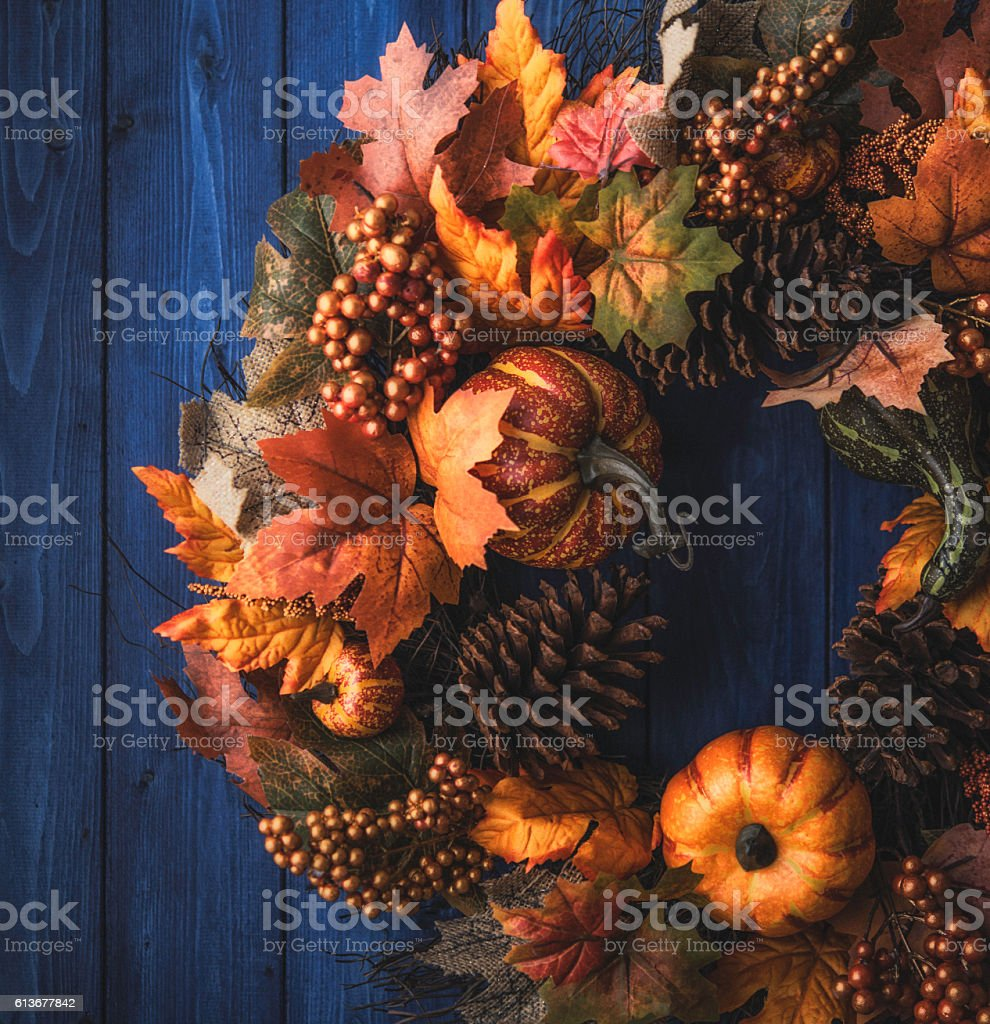 Ornate fall wreath with pumpkins, pinecones and leaves stock photo