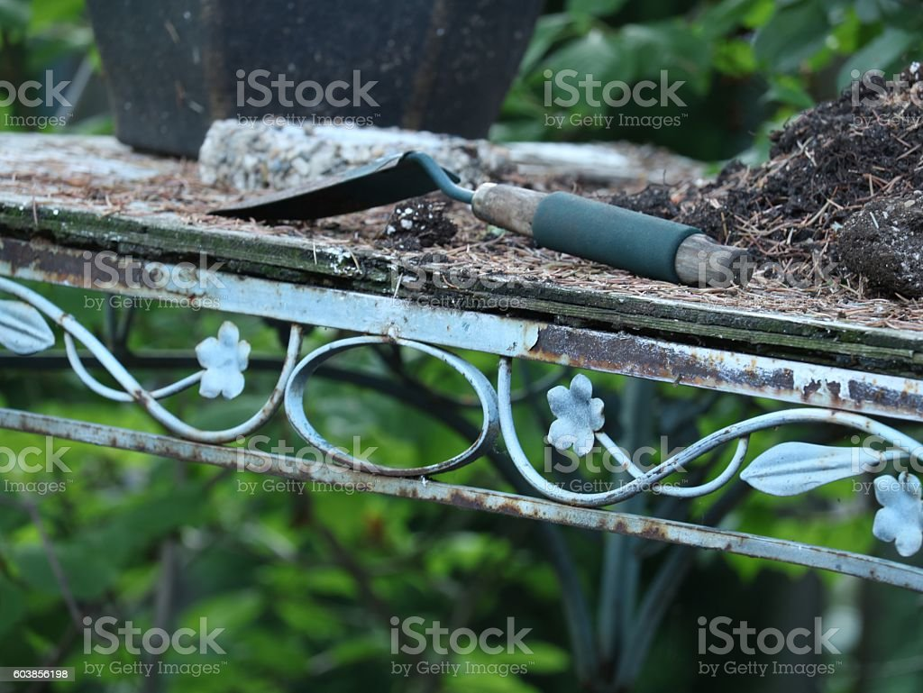 Ornate garden  potting bench with trowel stock photo