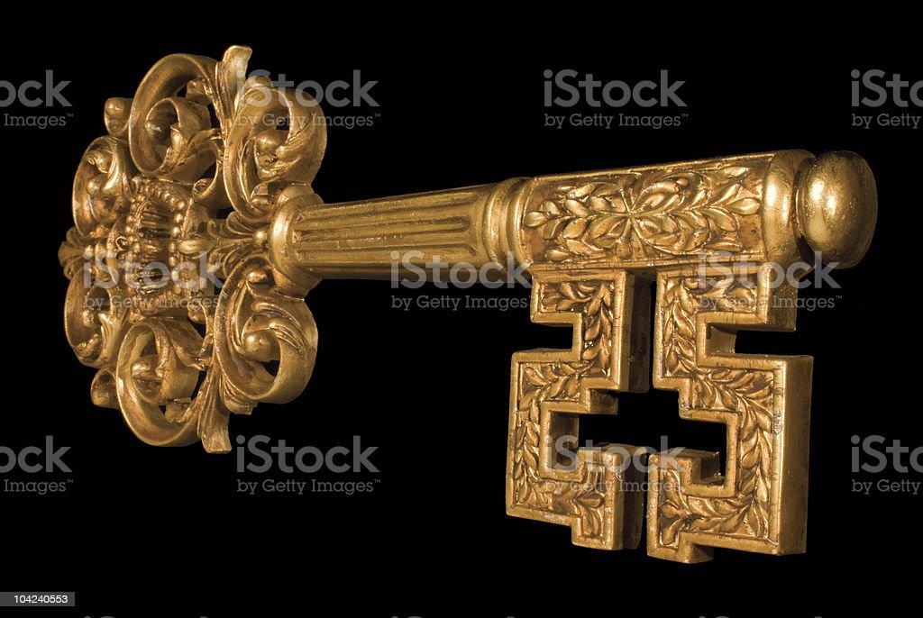Ornate Gold Key at an angle stock photo