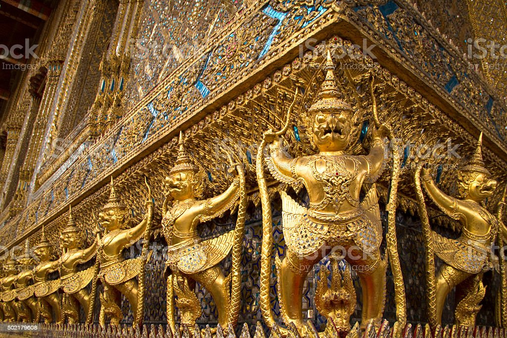 Ornate golden garuda figures adorning temple stock photo