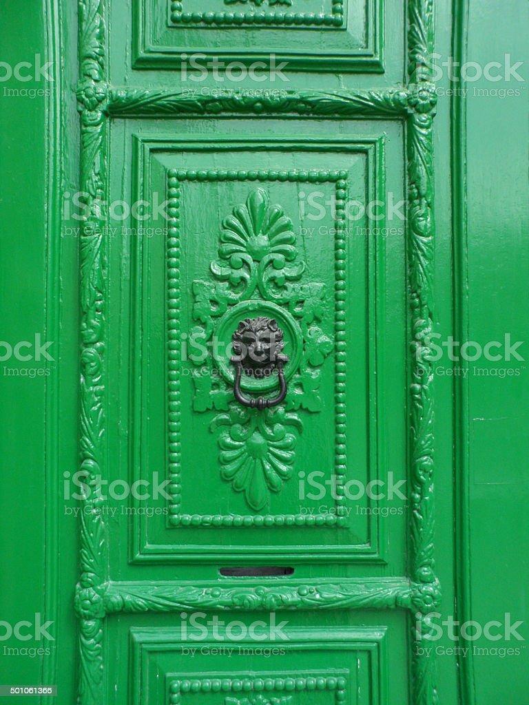 Ornate Green Door with Lion Door Knocker stock photo