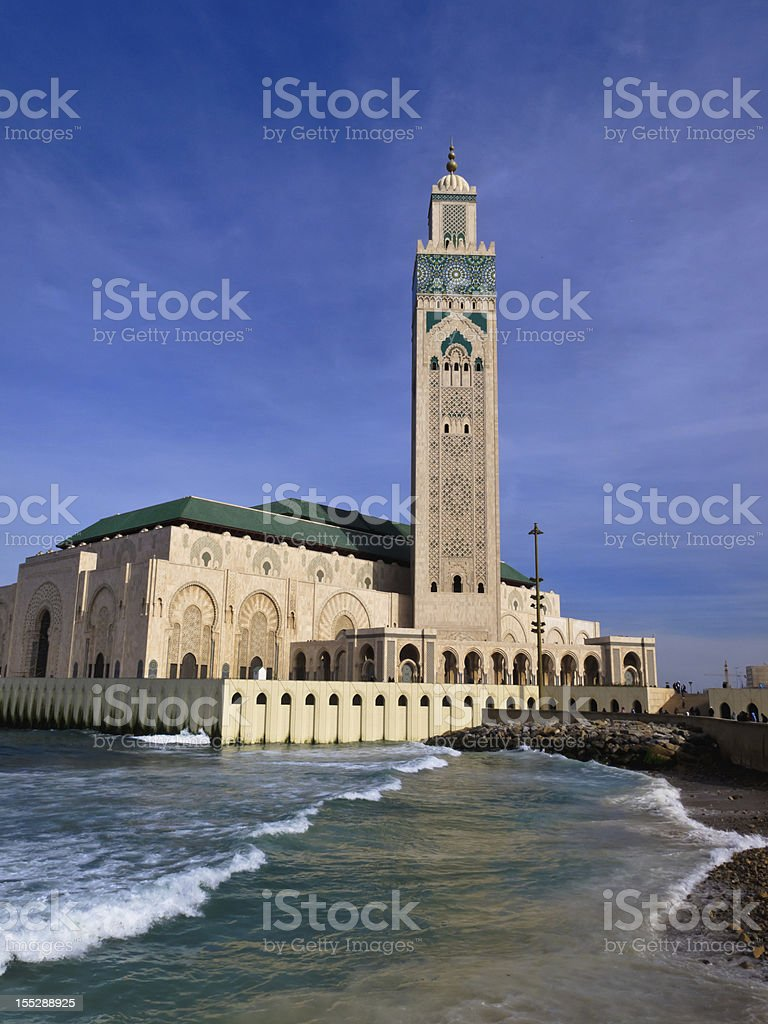 Ornate Hassan II Mosque against blue sky royalty-free stock photo