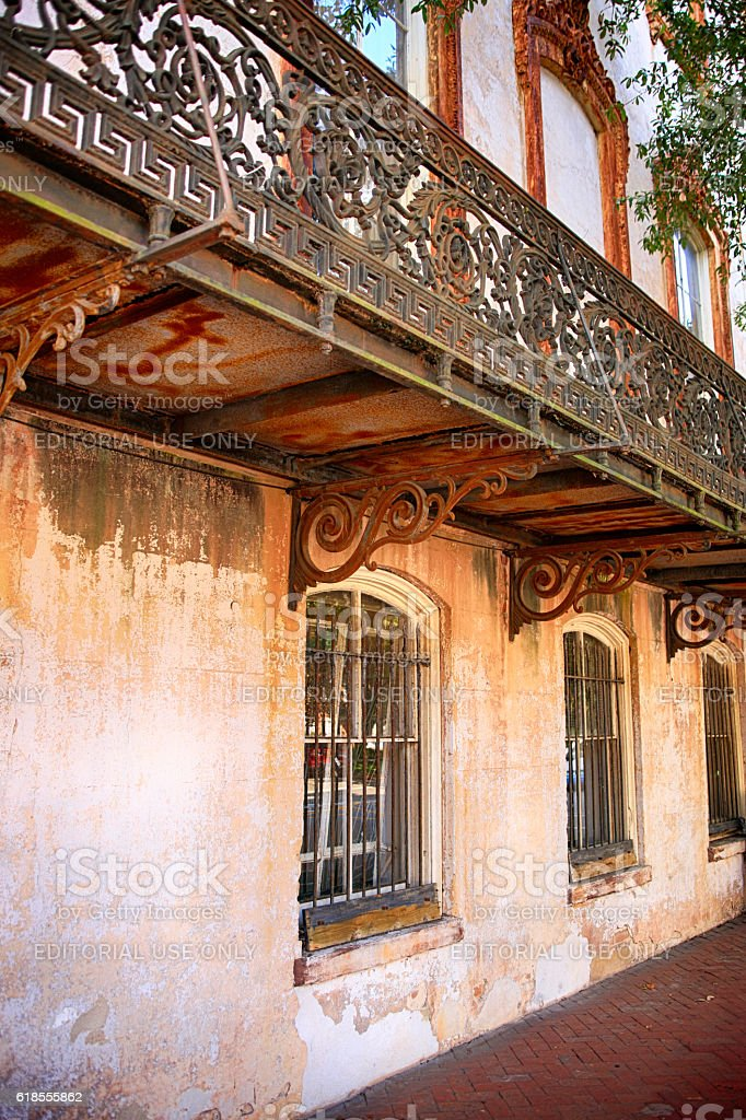 Ornate ironwork balcony attached to a home in Savannah, GA stock photo