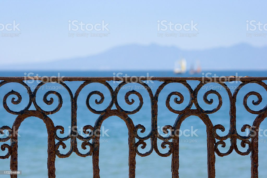 Ornate Ironwork Railing with Ocean View of Puerto Vallarta, Mexico stock photo