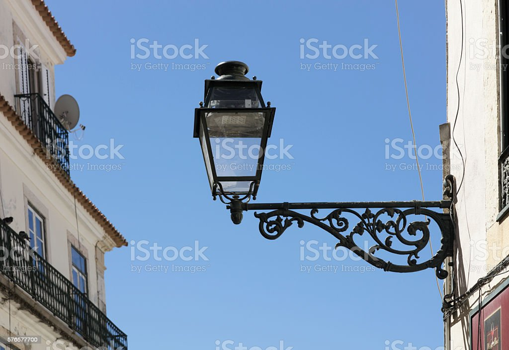 Ornate ironwork street lamp stock photo