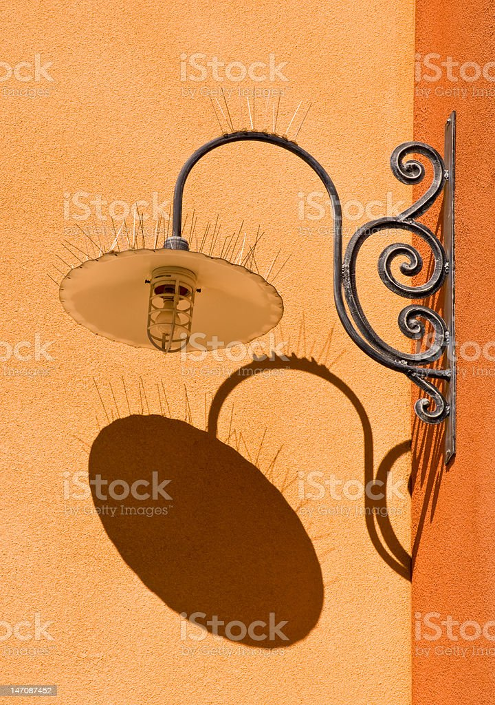 Ornate Light Fixture and Shadow royalty-free stock photo