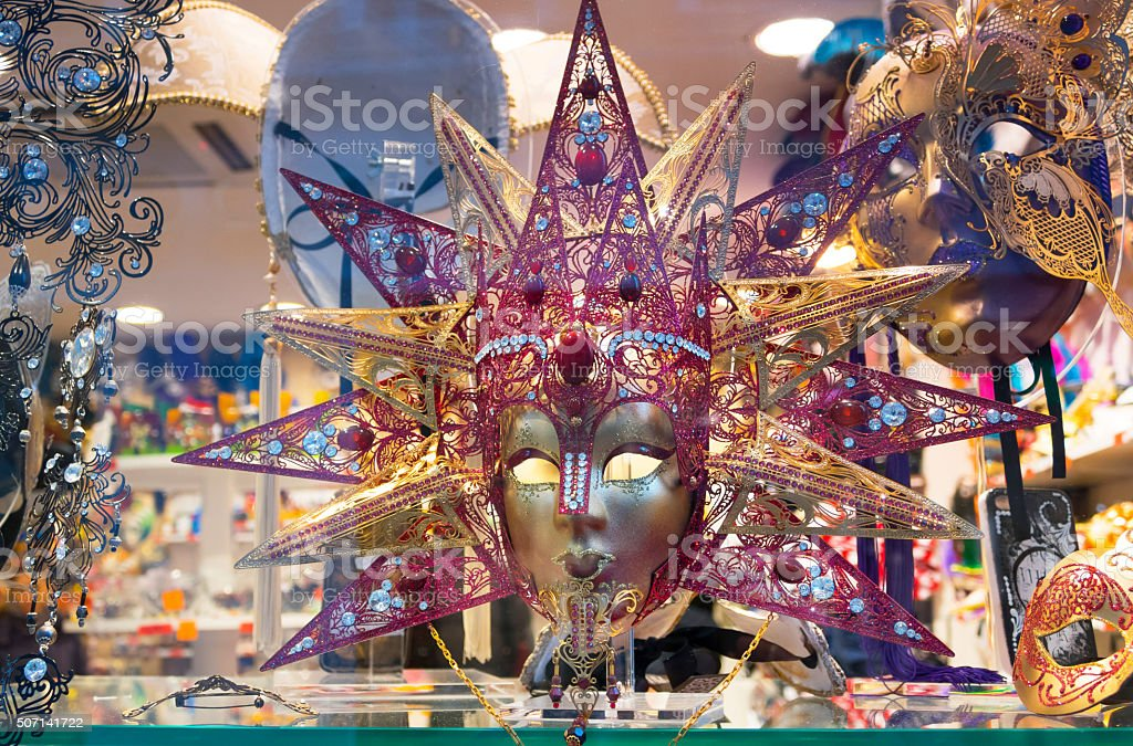 Ornate mask from Venice carnival-pink and gold stock photo