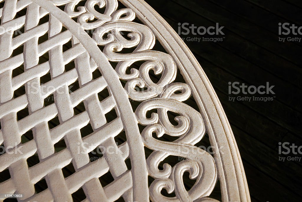 Ornate Metal Table on Wood Patio stock photo