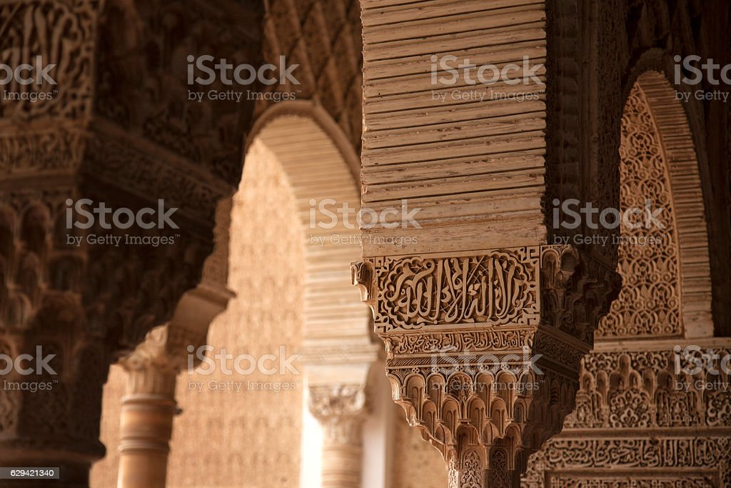 Ornate pillars and arch in Alhambra stock photo
