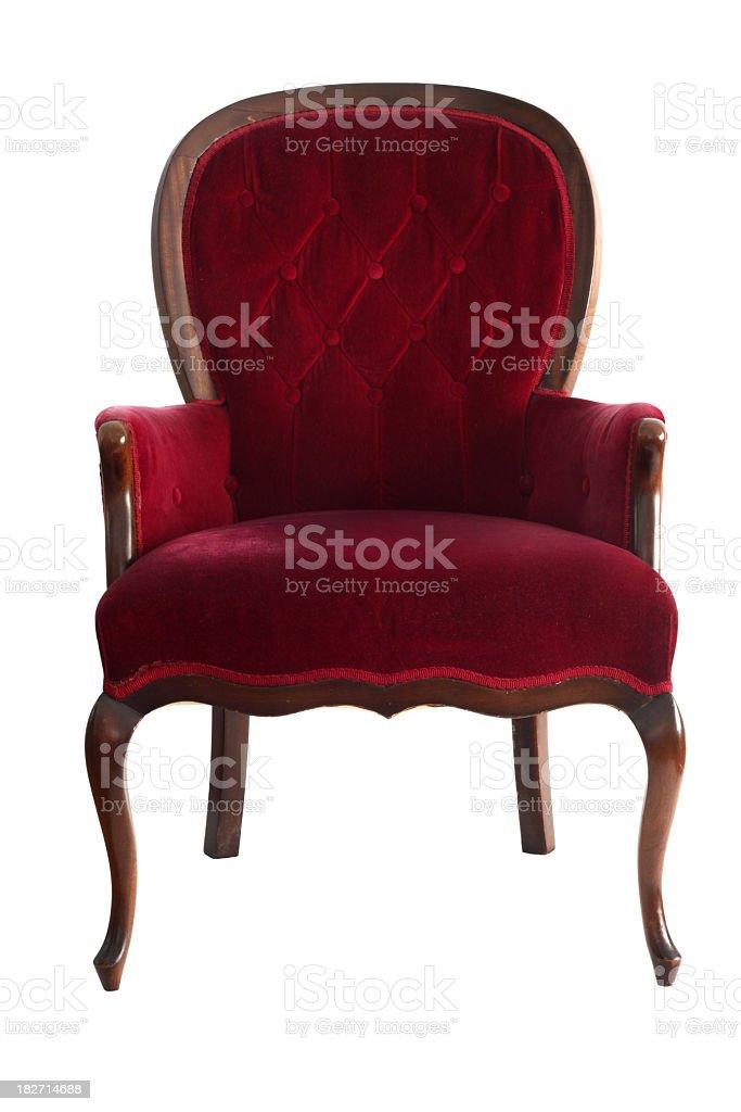 ornate red velvet chair shot from front on white background stock photo