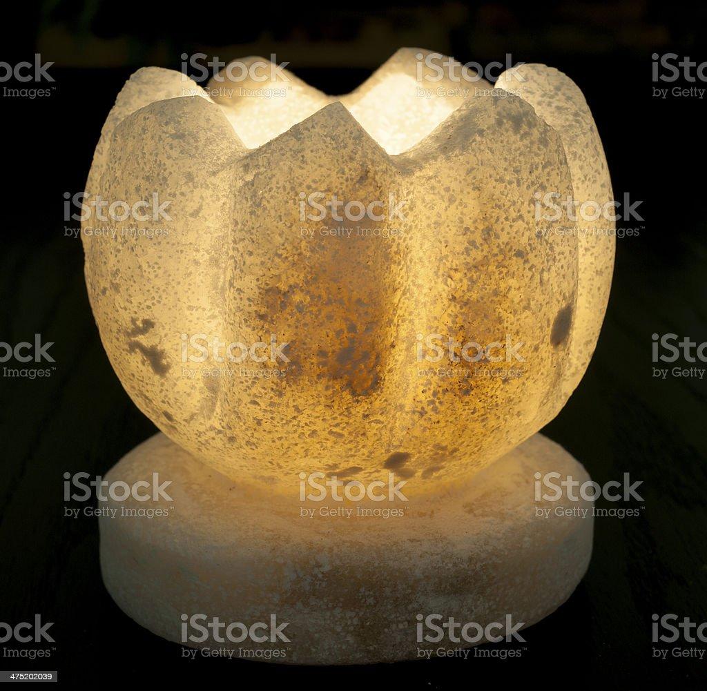 Ornate salt candle on black background royalty-free stock photo